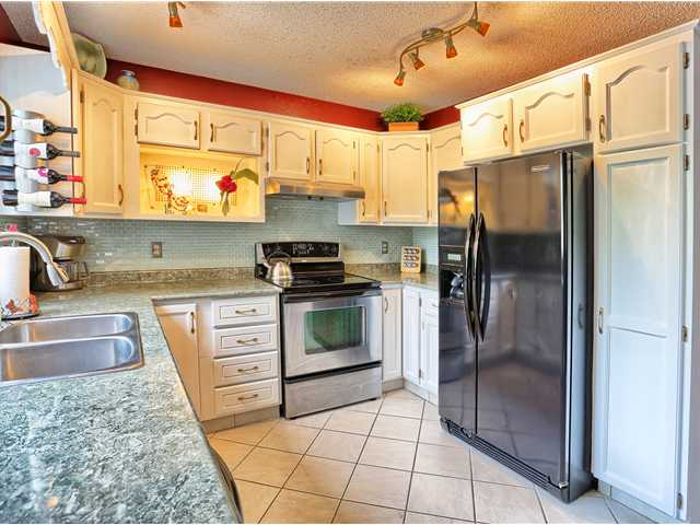 Large bright kitchen offering plenty of counter space and cupboards