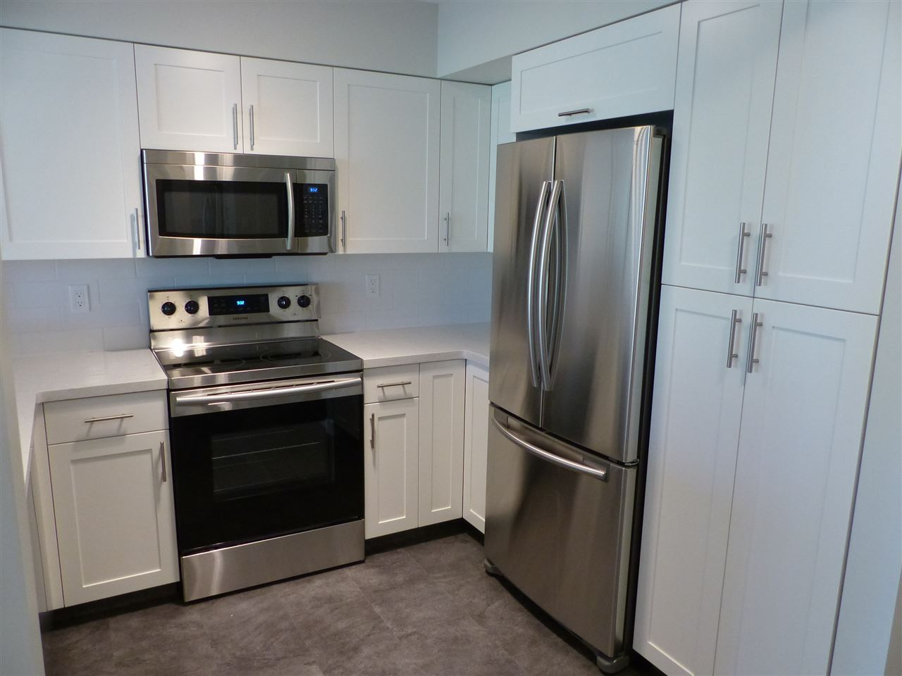 All NEW Kitchen, NEW Samsung Stove, Dishwasher, Microwave, Fridge c/w Ice Maker