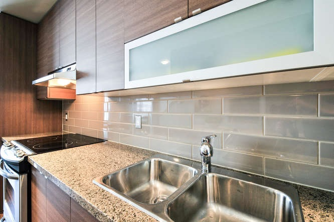 Granite counters, stainless steel appliances & ceramic tile back splash