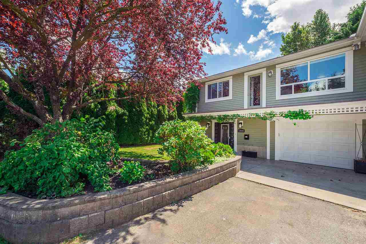 Main Photo: 12646 93A Avenue in Surrey: Queen Mary Park Surrey House 1/2 Duplex for sale : MLS® # R2181340