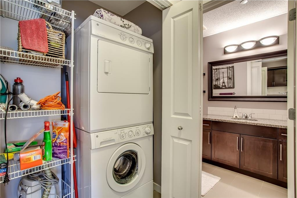 In suite laundry with storage.