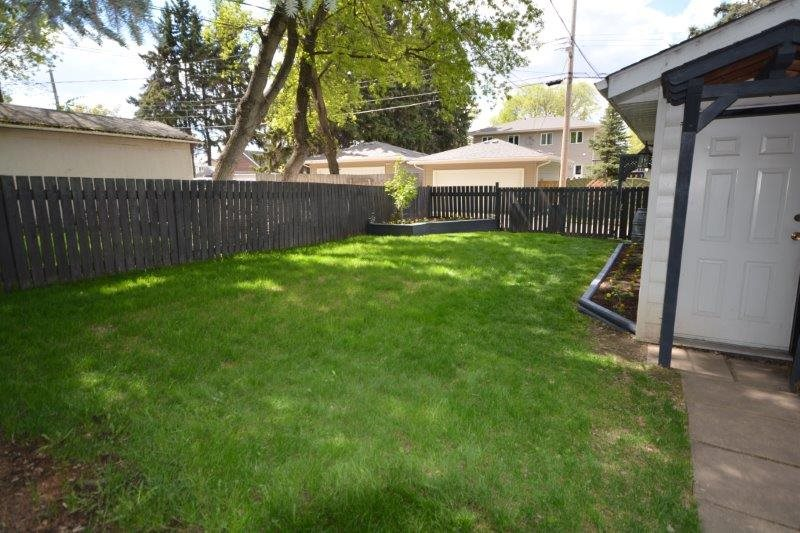 The back yard fence swings open for uses such as storing your RV on site, over the winter!