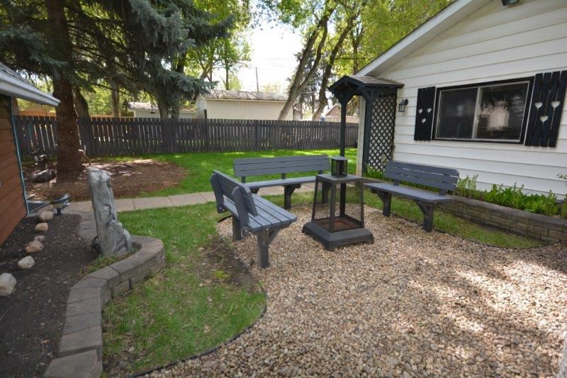 Enjoy summer campfires in the back yard.  In this mature neighbourhood it will feel like you are at the lake!