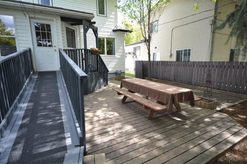 Lots of room to entertain on the back deck/patio.  The ramp could easily be dismantled to uncover the stairs underneath.