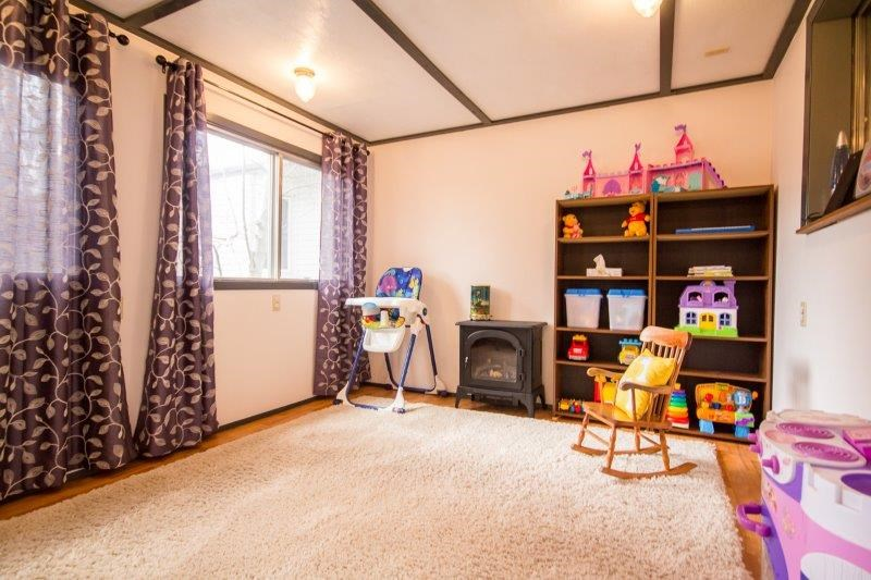 At the back of the home, this room could be a play area, den, bedroom or whatever your needs are.