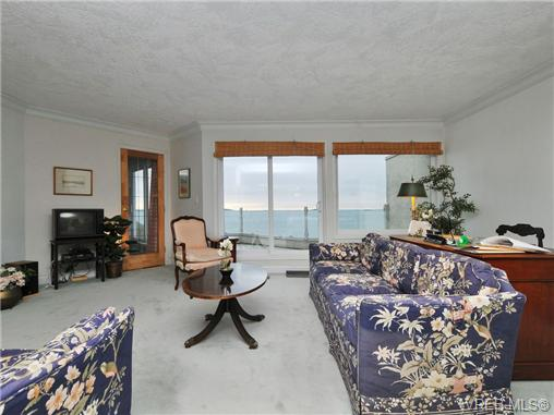 Living room that looks to deck and ocean. Door leads to master b