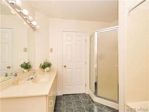 Master ensuite bathroom has shower over tub plus free-standing s