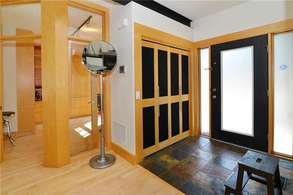 Spacious Front Entrance: mirror is included with the home