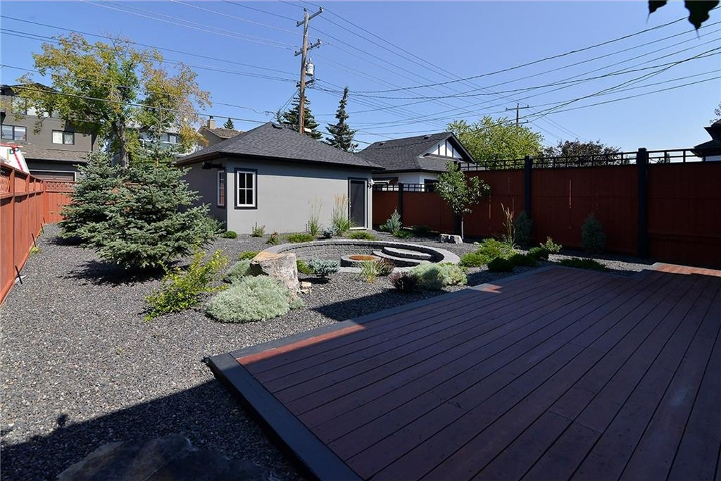 Professionally landscaped backyard with double garage.