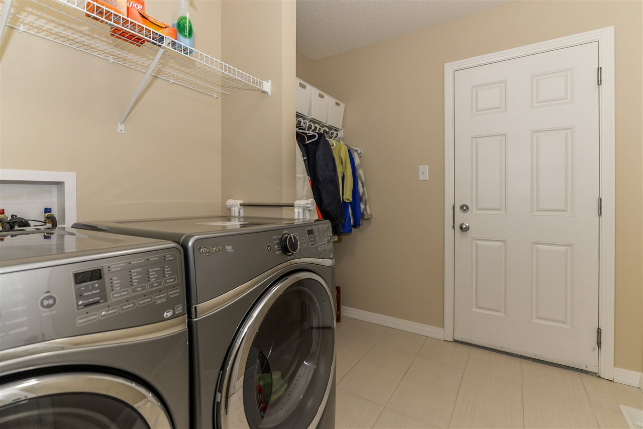 Main floor laundry just off the garage. Yes, washer & dryer included