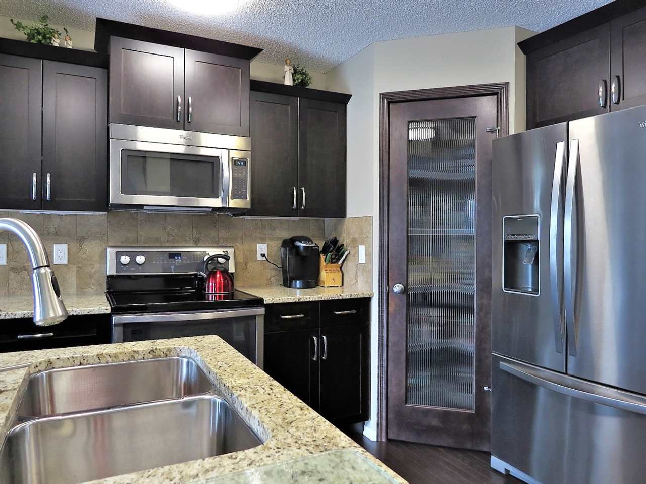 Granite, upgraded cabinets, upgraded lighting with under cabinet lighting, S.S. appliances and lots of counter space make this kitchen a pleasure to prepare meals in!