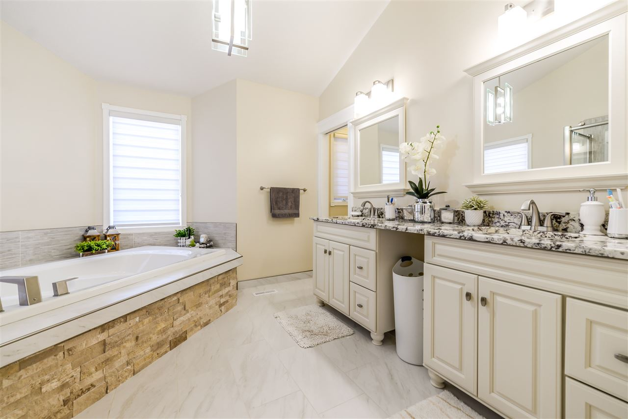 More than an ensuite! This is spa like for greeting the day and soaking your cares away at the end of the day. For a communal soak wait to see the hottub room! Granite counter tops, stone accents, shower and bath and you won't want to leave..