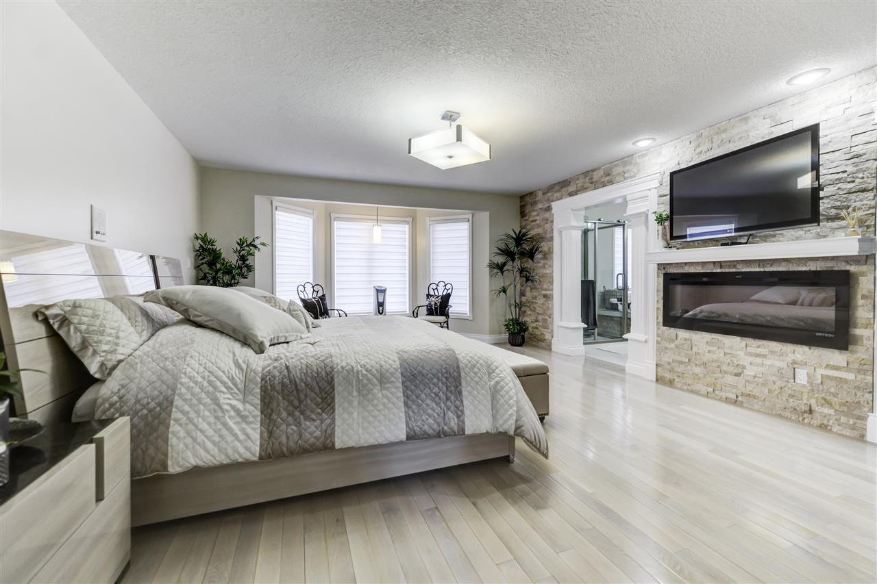 King sized bed and room for another! Hardwood floors, electric fire place, walk in closet and a stunning Ensuite!