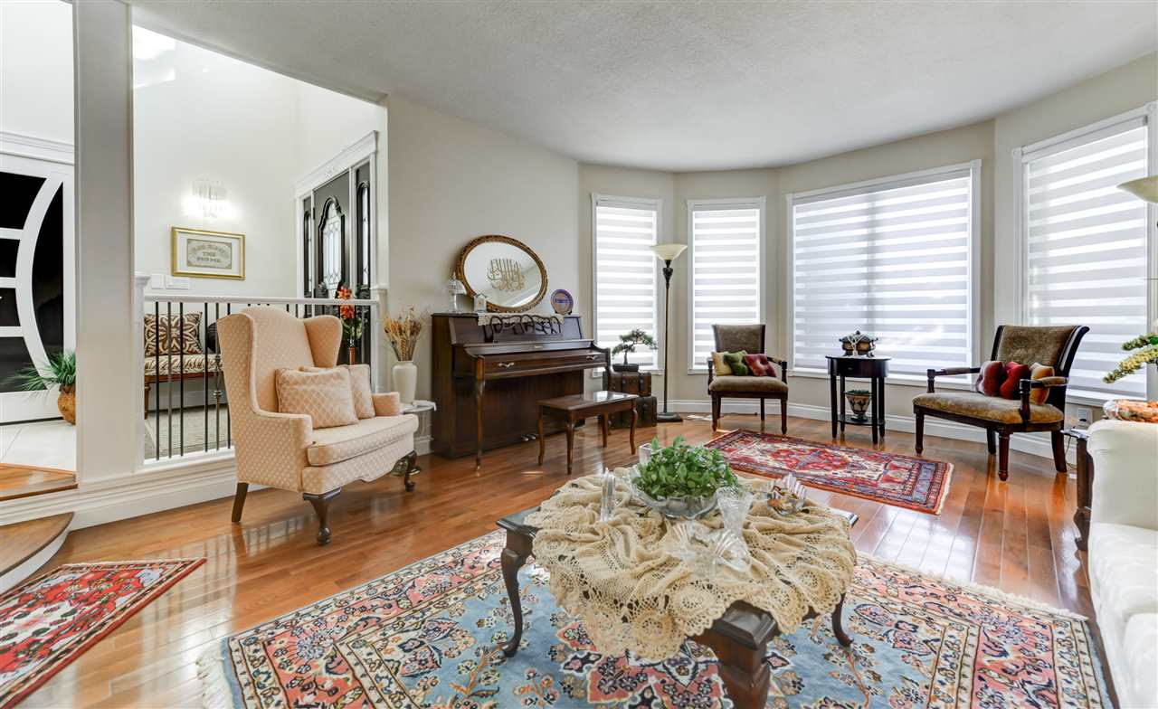 This is a beautiful room and so spacious! Lots of natural light that sets the mood.