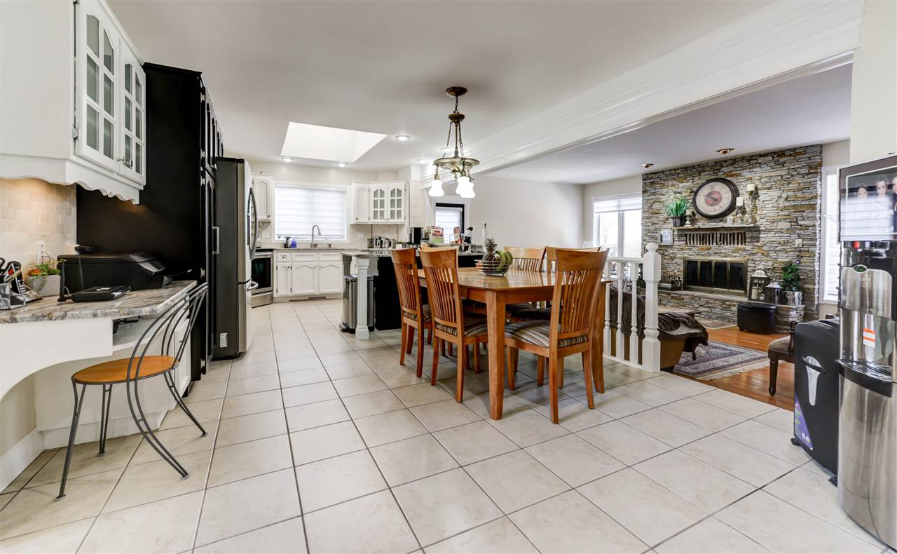 A great spot for the family to gather. Granite counter tops and loads of cupboards. Room for all around the table and open to the family room.