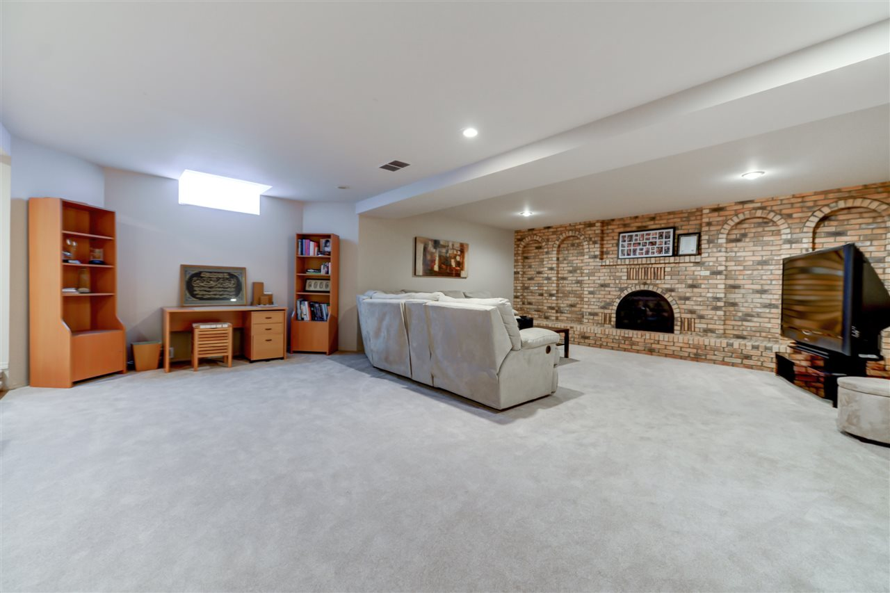 Huge lower level, open with a dance floor, fire place, two bedrooms a bath , storage and a stairway up to the garage.