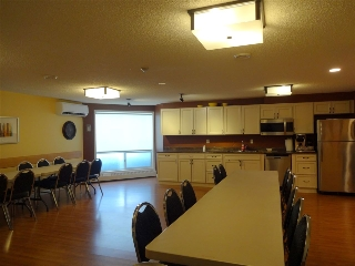Party Room.  Huge area, with kitchen and 2 piece bathroom.  Perfect if you like to entertain.