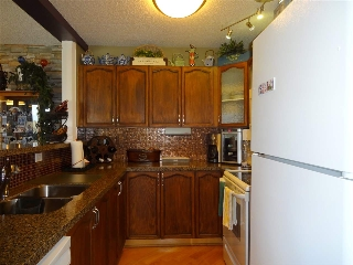 Beautiful kitchen with plenty of cupboards and counter space.