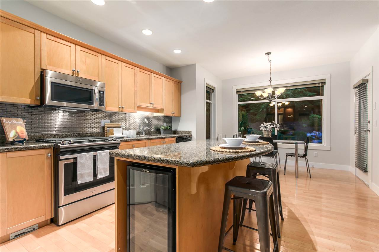 This beautiful kitchen has an open concept for you to entertain while still being in the midst of it all.  A breakfast bar attached to the island and space for your kitchen table.