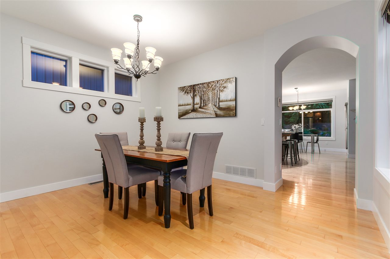 The spacious dining room that would be great for entertaining. This space could easily fit a large table for all of your family and friends to enjoy.