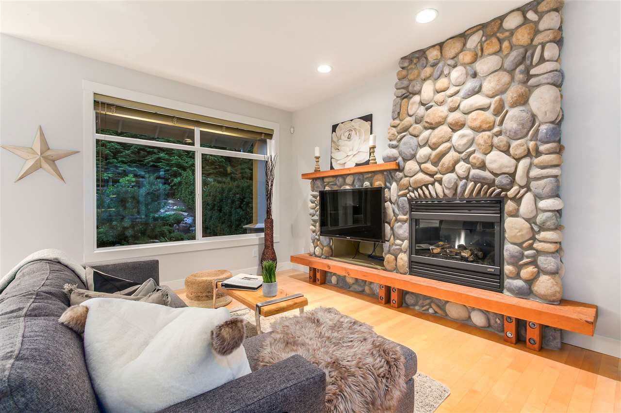 This cozy family living area is your go-to spot at the end of a long day. A perfect spot to curl up in front of a nice fire, to read a book, watch your favorite show or just hang out with friends and family.