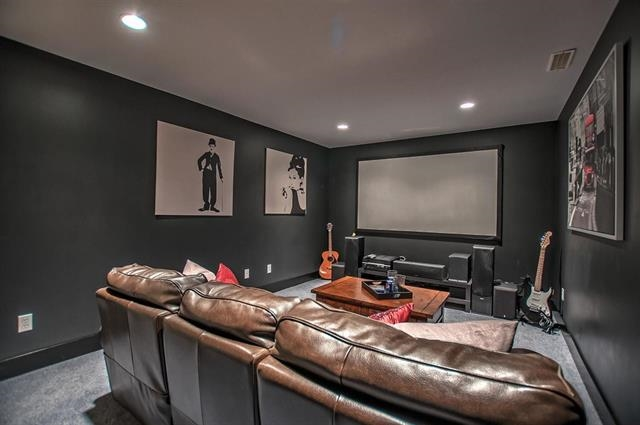 A beautifully done media room is perfect for movie night for friends and family to enjoy!