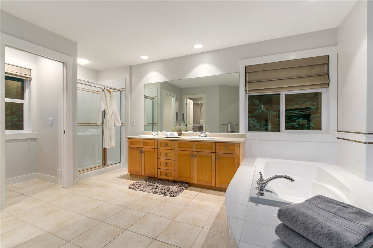 This spacious 5 piece master bathroom is exceptional.  Double sink, deep bath, shower, double sided fireplace and multiple windows brings so much light into this space.