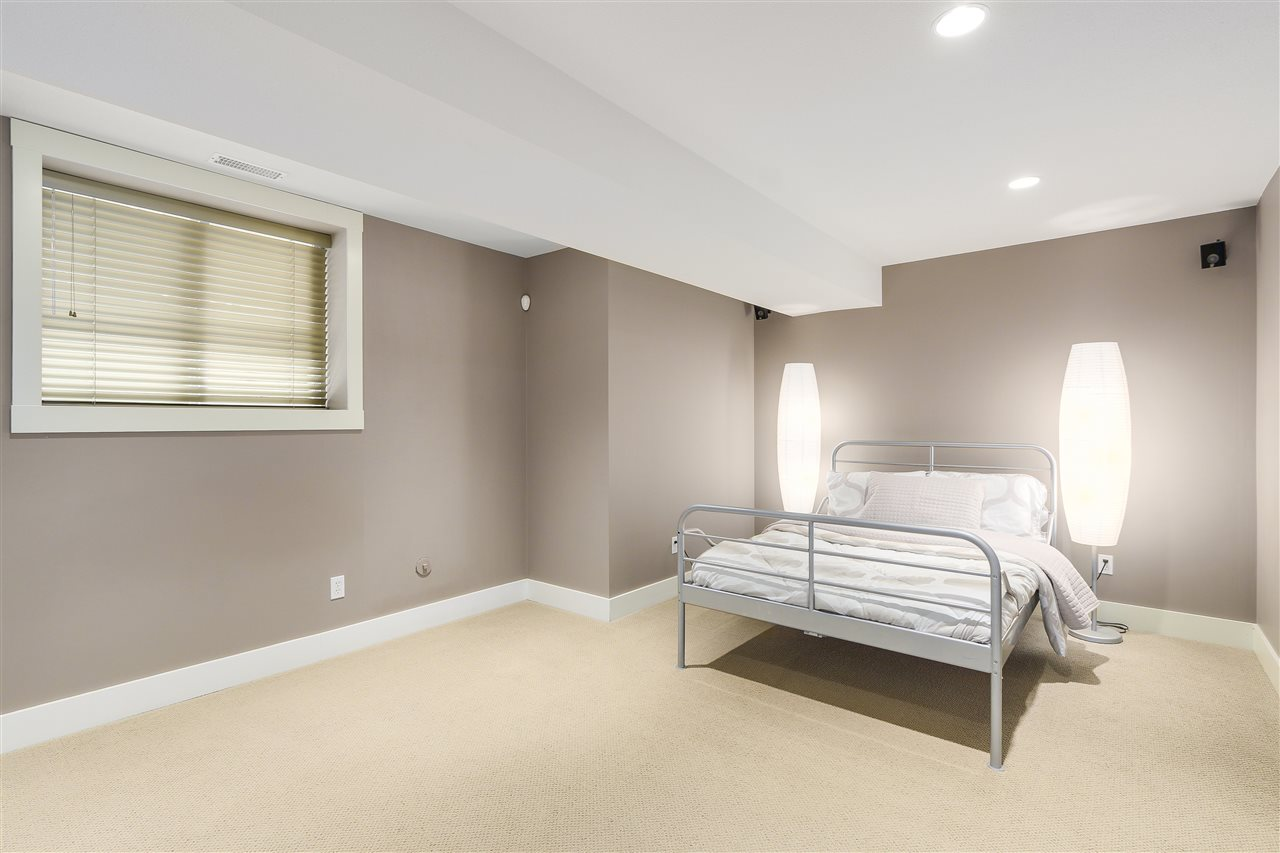 This large bedroom is located on the lower level with a big window that allows all that natural light to shine through.