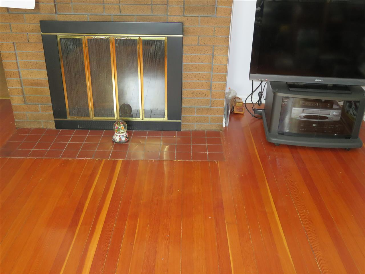 Fir floors and wood-burning fireplace in Living Room!
