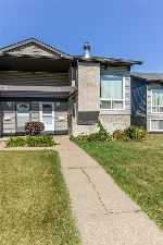 Main Photo: 11 NORTHWOODS Villa in Edmonton: Zone 27 House Half Duplex for sale : MLS® # E4079729