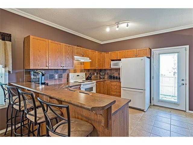 Photo 9: 301 2006 LUXSTONE Boulevard SW: Airdrie House  : MLS® # C4034048