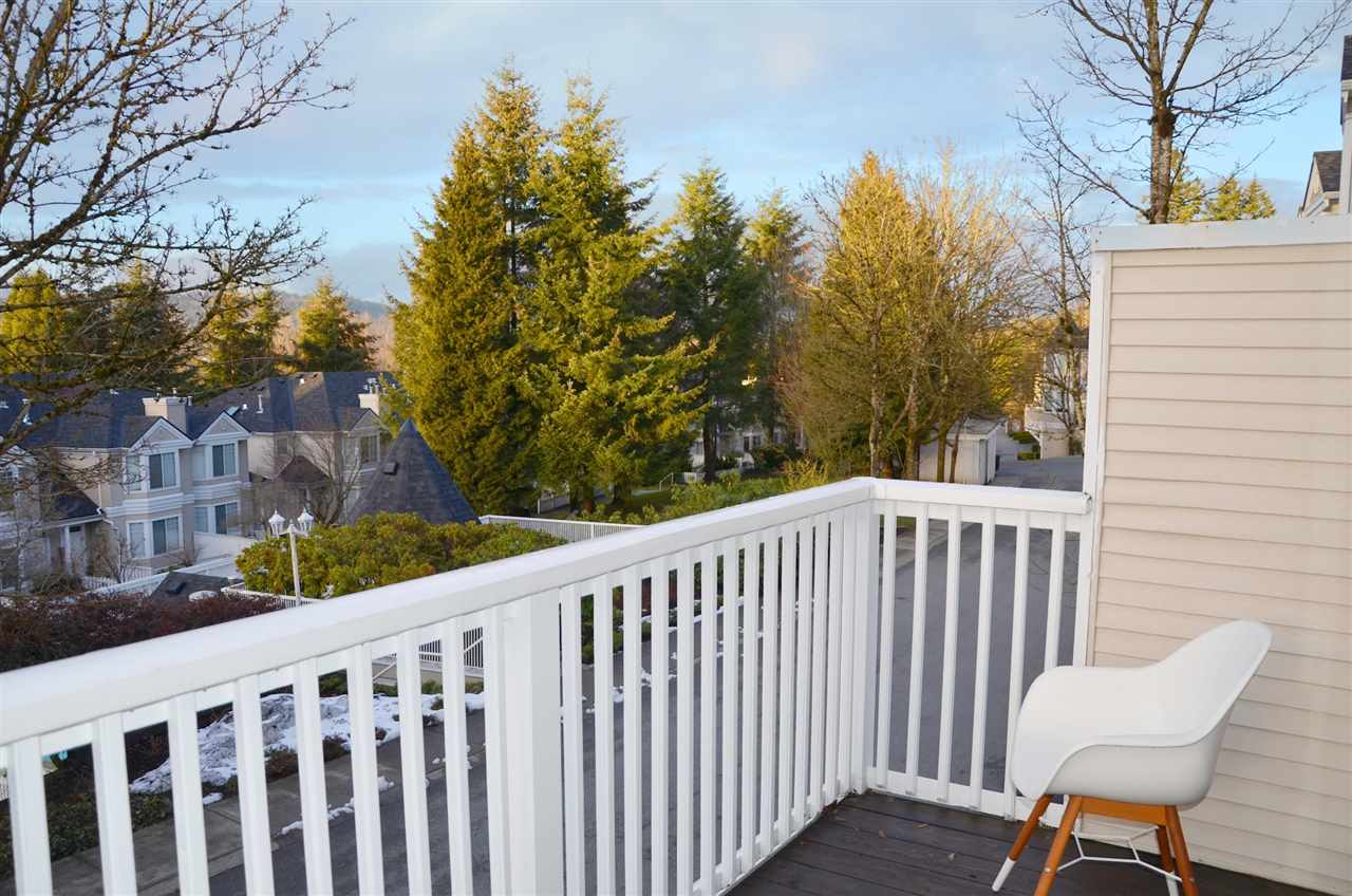 Balcony/Deck with view of green space