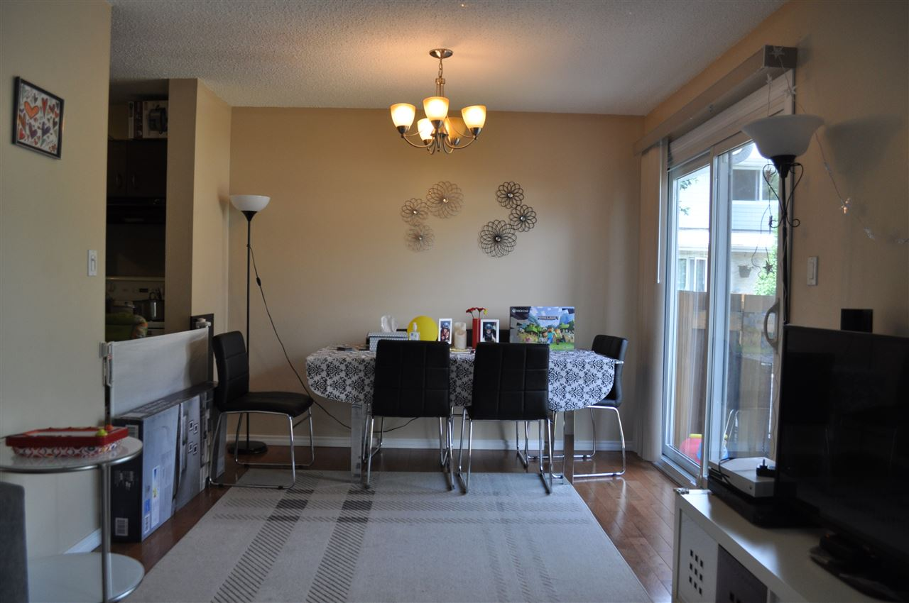 Just off the kitchen, the dining area supports a family sized table, and enjoys loads of light from the patio doors