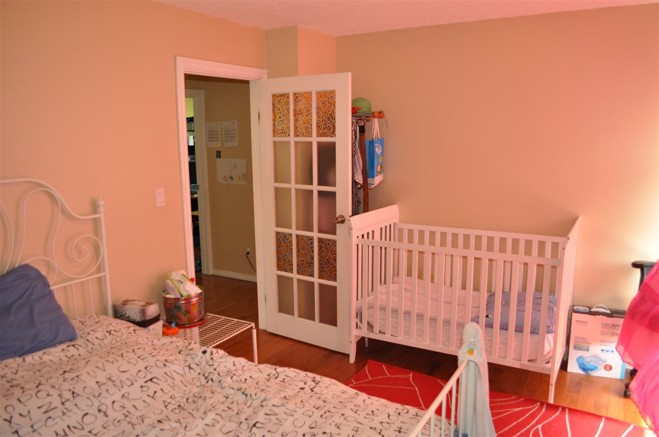 The master bedroom has double closets, and easily supports king sized furniture. Currently used by the kids so that they have extra space to play, it easily shifts back