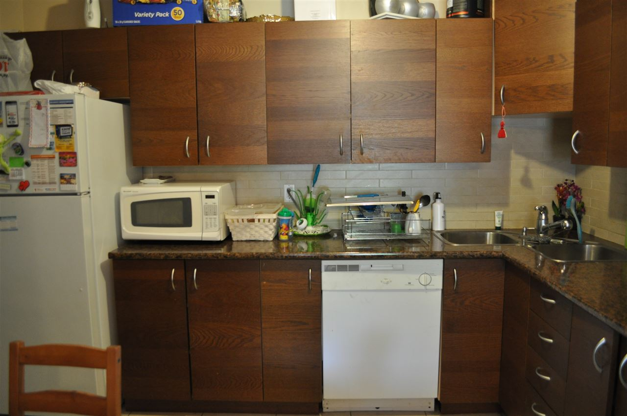 With ample new cabinetry, the kitchen has great work and storage space