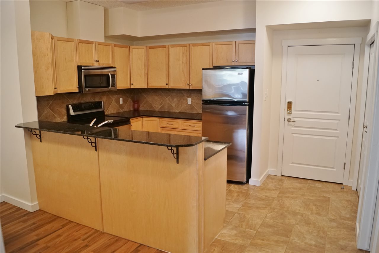 2) Maple cabinetry, granite countertops, stainless steel appliances