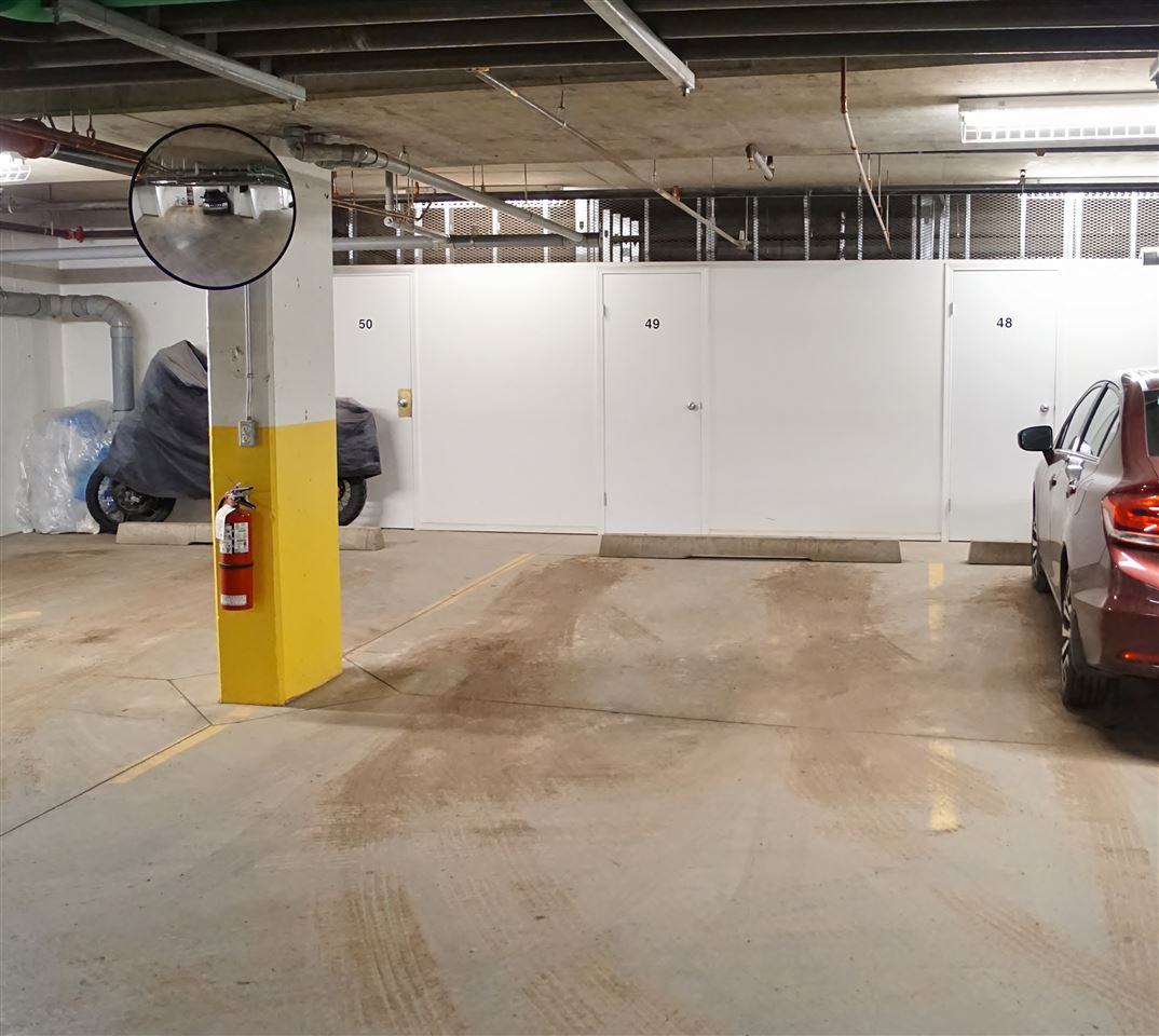 21) Heated, titled underground parking stall with enclosed storage at front of stall