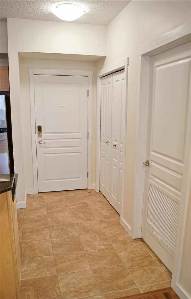 3) Tiled spacious entryway with coat closet