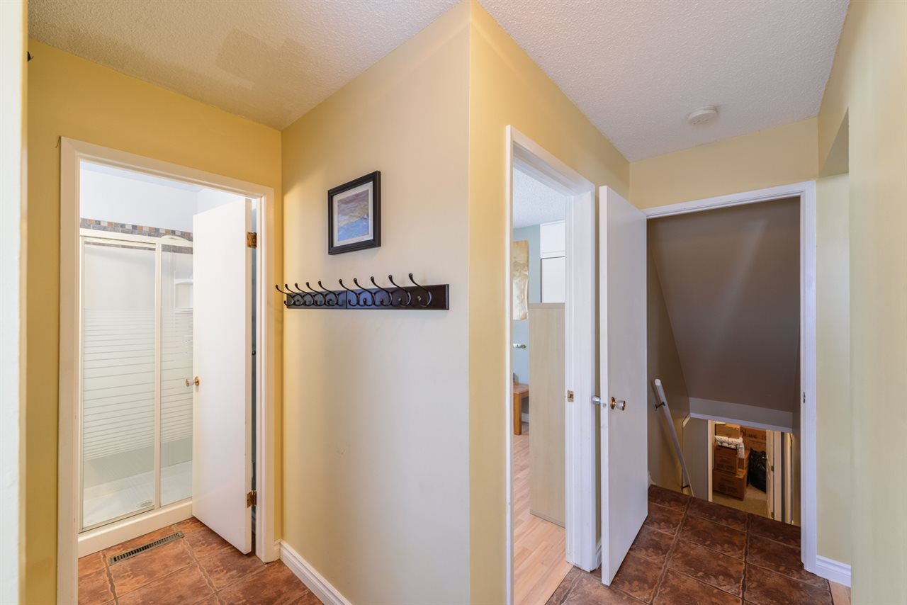 A view from the side entry into the mudroom area, with access to the basement, 4th bedroom and a 3 piece bath.