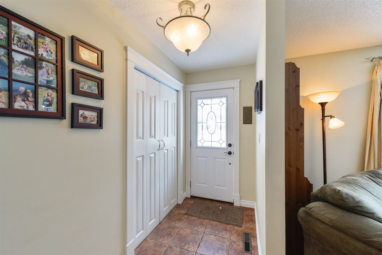 Warm, inviting entry with easy to maintain tile flooring.
