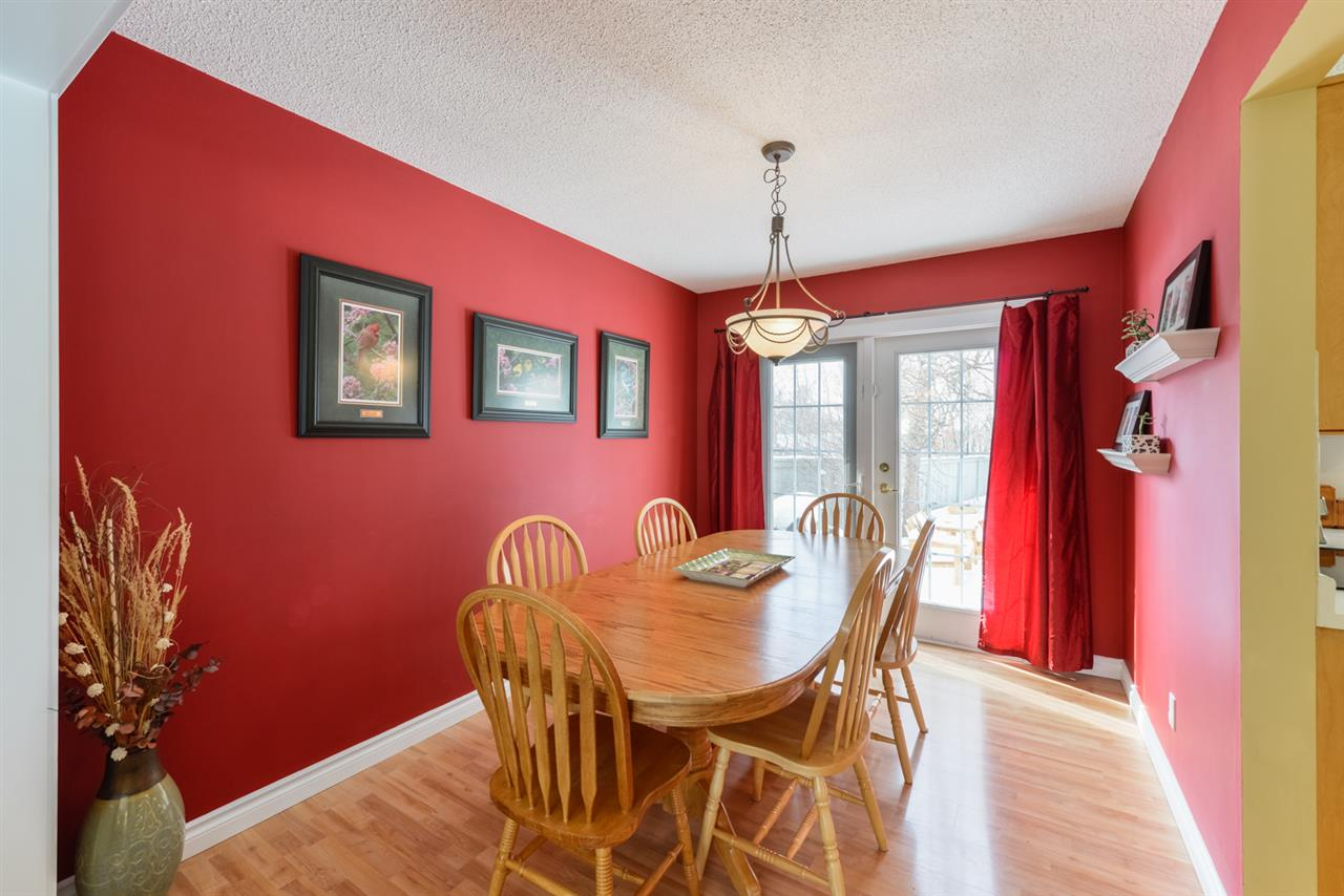 The dining room boasts lovely french doors which lead to a large deck and private, landscaped SW yard.