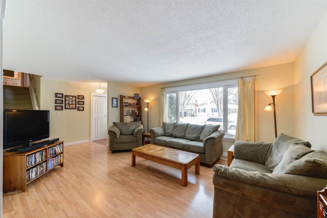 The spacious living area has a large picture window and plenty of seating space.