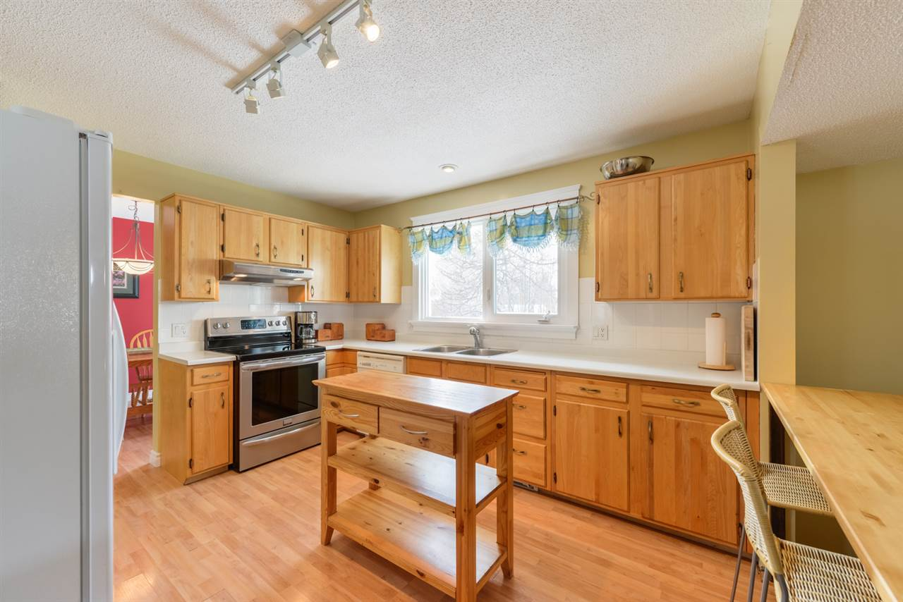 The spacious kitchen has a convenient eat-in breakfast bar and loads of prep and storage space.