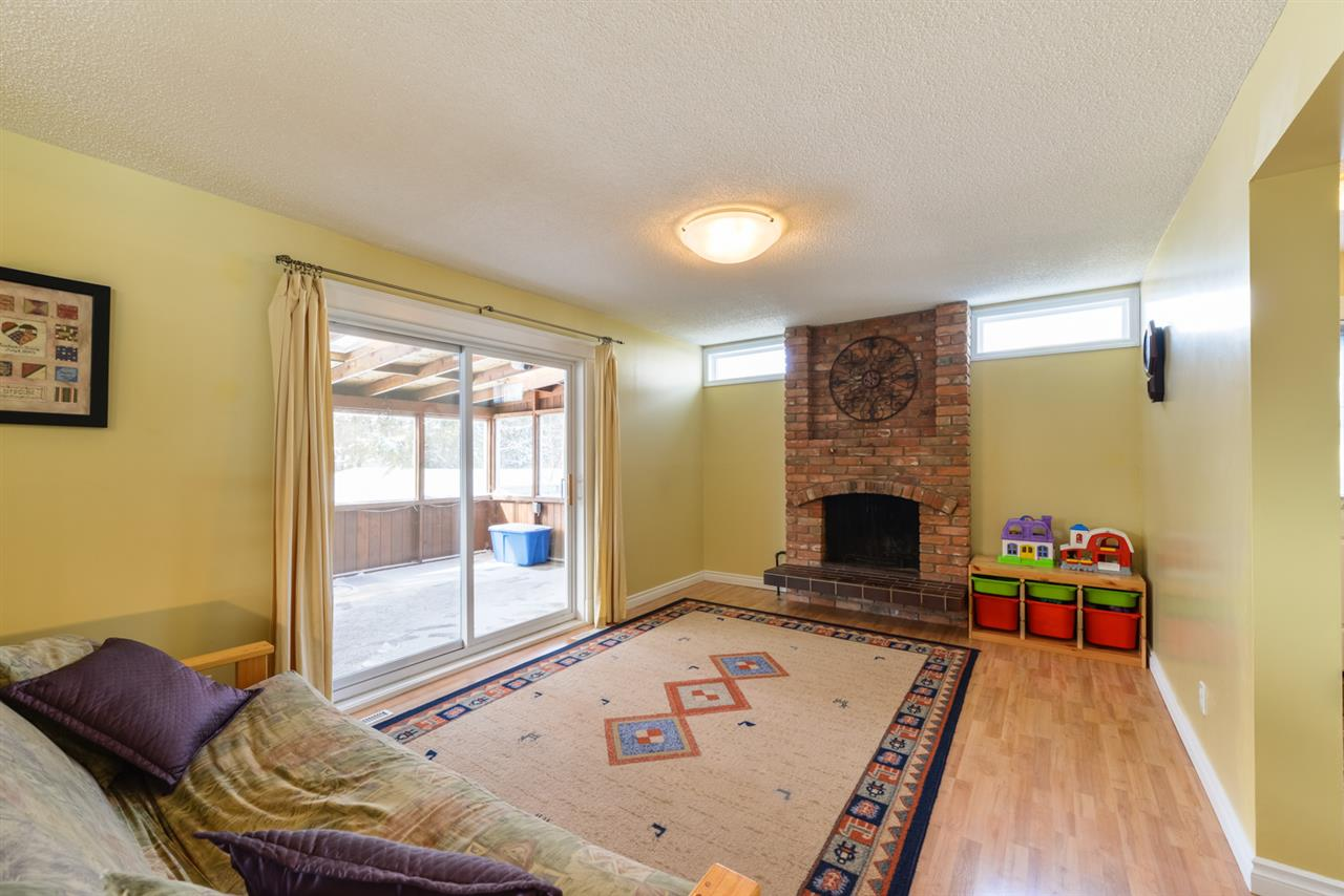 The family room leads to a lovely sun-room which overlooks the private back yard.