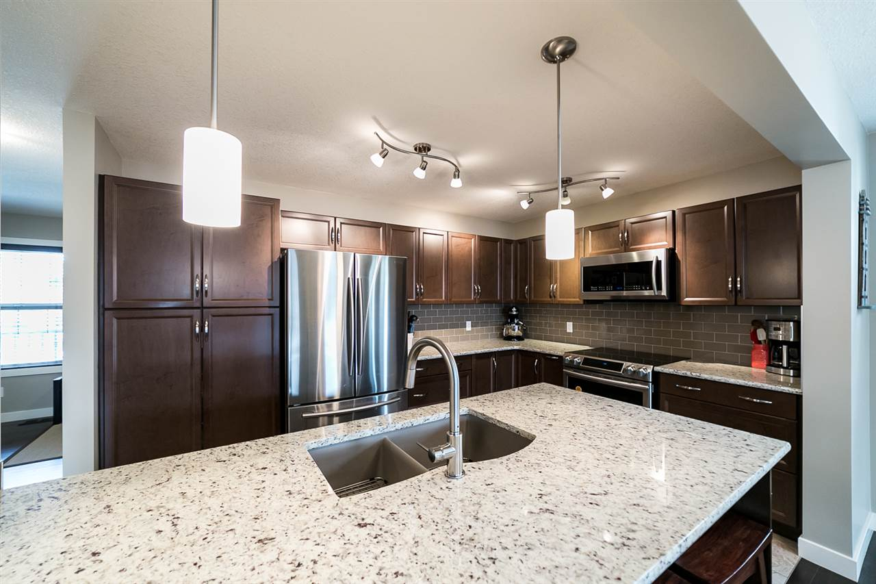 Large granite island, spacious pull out pantry.
