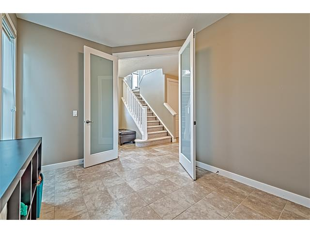 Main floor flex room with double glass doors leading to foyer.