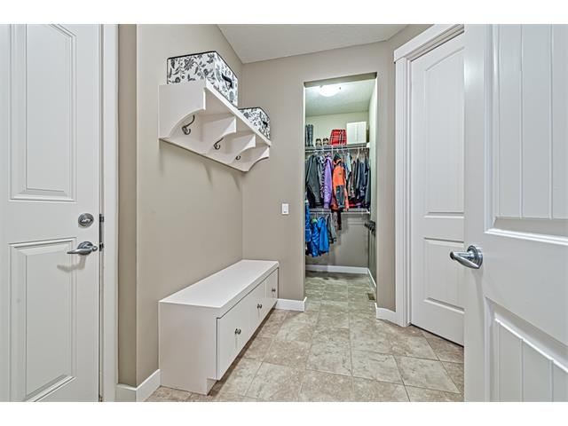 Mudroom with large closet, built-ins, and lockers, ideal for any family.