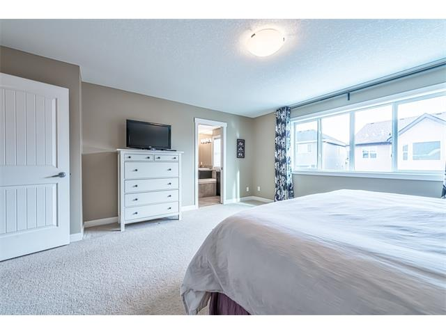 Master bedroom with huge picture window allowing for loads of natural light.