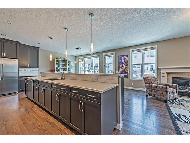 Open concept plan with amazing island with raised eating bar, ideal for entertaining.