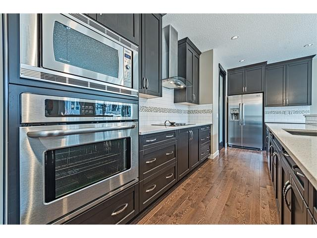 High end stainless steel appliances including built in microwave and oven.